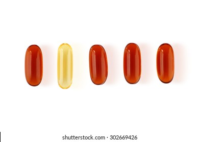 A single yellow pill in a row of orange pills, a concept of individuality and diversity. Isolated on a white background.