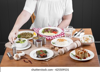 Single Young Beautiful Curly Hair Woman waiting before have dinner, sitting alone at the table