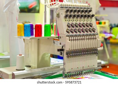 Single-head, 15-needle Table Embroidery Machine. (Selective focus)