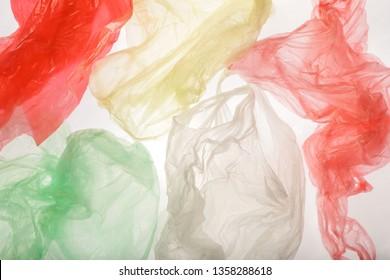 Single-use plastic bags background, studio shot. Plastic pollution concept.