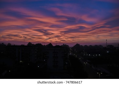 Singular sunset with brush clouds