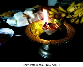 Sinhalese New Year, food table with coconut oil lamp Sinhala and Tamil new year Sri Lanka