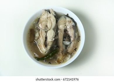 Sinigang na bangus or milkfish in sour broth is a Filipino Traditional Dish. The sour taste of tamarind gives the distinctive taste of the broth. Flat Lay isolated on white shot.