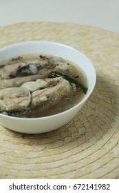 Sinigang na bangus or milkfish in sour broth is a Filipino Traditional Dish. The sour taste of tamarind gives the distinctive taste of the broth. Perspective shot.