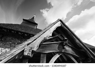 Sinister creepy looking church steeple and roof in an expressionistic style in black and white