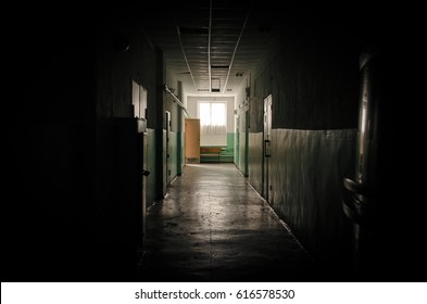 Sinister dark corridor and day lights in the window in the end. Light at the end of the way concept.