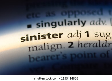 sinister word in a dictionary. sinister concept.