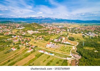 Sinj. Town of Sinj and Cetinaka Krajina panoramic view, Dalmatia inland region of Croatia - Shutterstock ID 1933769849