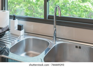 sink with faucet in kitchen room, modern counter with sink in kitchen room, interior design concept
