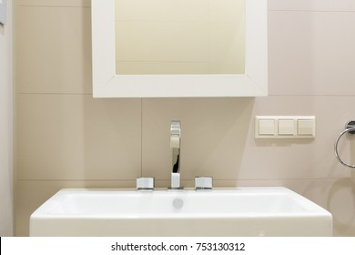 Sink and mirror in the bathroom