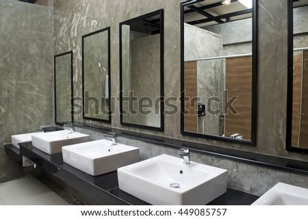 Public bathroom mirror Interior Sink With Mirror In Public Restroom Shutterstock Sink Mirror Public Restroom Stock Photo edit Now 449085757