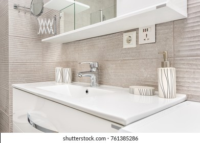 Sink with shelf and mirror in modern bathroom