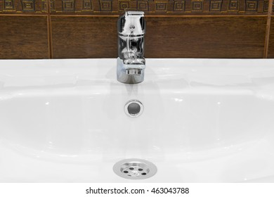 sink, and shiny faucet in the bathroom
