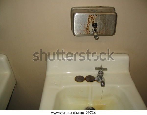Sink and soap dispenser