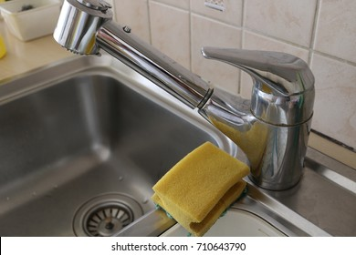 sink with sponge in a kitchen