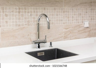 Sink with a tap from the kitchen