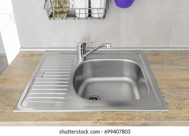 Sink for washing dishes. Part of the kitchen interior.