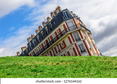 Sinking house on Montmartre hill taken with funny angle, Paris, France in sunny day