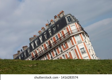 The Sinking house, a parisian building on Montmartre hill, an optical illusion taken from an unusual angle, Paris, France.
