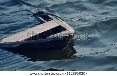 A sinking parts of a boat in the water isolated unique photograph