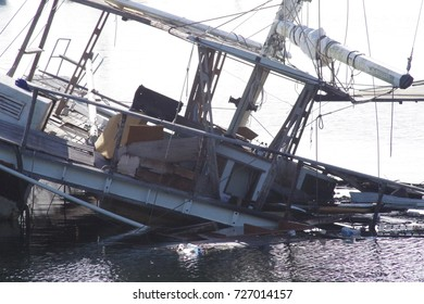 Sinking sailing boat following severe weather.