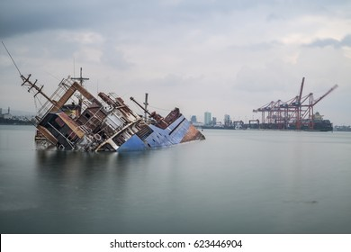 Sinking ship. Industrial sea port of Mersin. Turkey
