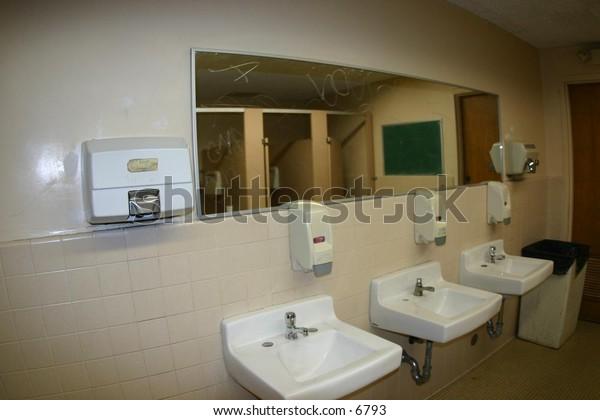 sinks and a mirror in a public washroom