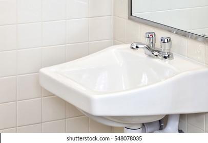 The sinks  in a modern public men's room.