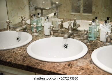 Sinks in the Public Restroom, Retro Style Mirrow and Taps