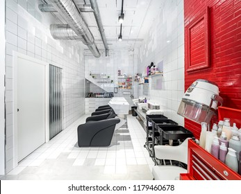 Sinks and retro hair dryer in a industrial beauty salon. Walls with hair products in a hair salon and make up store, barber shop and manicure interior business