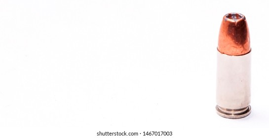 A sinlge 9mm hollow point bullet on a white background with added room for text