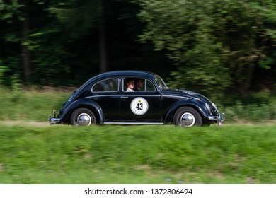 Sinsheim, Germany - July 13, 2007: Participants of the Heidelberg Historic Rally for classic cars are driving by in their Volkswagen Beetle Oldtimer car