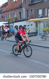 Sint Gillis Waas, Belgium, 2 September 2019, man with helmet and black bike is warming up to begin the race