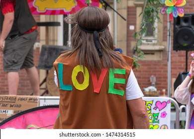 Sint Gillis Waas, Belgium, August 3, 2019, Remember Woodstock festival, love, peace and understanding. The hippie movement. Hippie with the LOVE inscription on his back