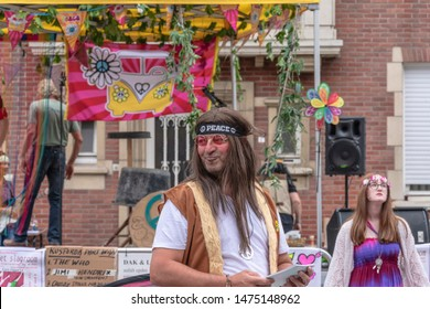 Sint Gillis Waas, Belgium, August 3, 2019, Remember Woodstock festival, love, peace and understanding. The hippie movement. Hippie with the inscription peace on his bandada