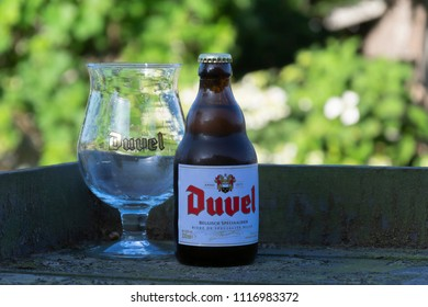 Sint Gillis waas, Belgium - June 20, 2018: Belgian beer Duvel with cold glass on a warm spring evening on a terrace in Sint Gillis Waas, Belgium.