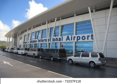 SINT MAARTEN - FEBRUARY 12: Taxi's lined up outside of world famous Princess Juliana International Airport where airplanes land just over people's heads in Sint Maarten on February 12, 2012.