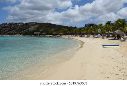 Sint Michiel, Curacao July 19, 2020: a usually popular beach in Curacao, now empty beach chairs and less tourists during the Covid-19 travel restrictions - sandy beach and turquoise Caribbean seas
