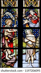 Sint Truiden, Belgium - April 21, 2013: Stained glass depicting the Baptism of Jesus by Saint John in the River Jordan, in the Cathedral of Saint Truiden in Limburg, Belgium.