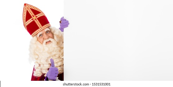 Sinterklaas or saint Nicholas holding blank cardboard. isolated on white background. Dutch character of Santa Claus