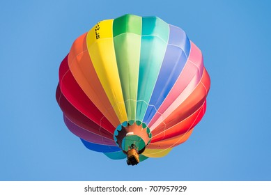 SINT-NIKLAAS, BELGIUM - September 2, 2017: a colorful hot air balloon rising up in the sky during the yearly international balloon meeting at Sint-Niklaas, Belgium.