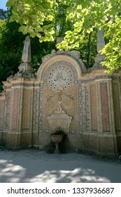 Sintra, Lisbon / Portugal -  May 18, 2018: Ancient mosaic fountain in the garden of Quinta da Regaleira, fountain of eternal youth.