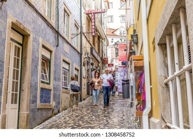 SINTRA, PORTUGAL - 03 JUNE, 2017: People walking in the Rua das Padarias in the center of the city. The area contains typical bakeries and shops.