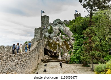 SINTRA, PORTUGAL - 11 JUNE, 2018. The Castle of the Moors, Castelo dos Mouros, is a hilltop medieval castle in Sintra, Portugal