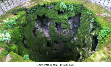 Sintra, Portugal - April 2018: Top view of the unfinished initiation well inside the tower of masonic Initiation Well at Quinta da Regaleira