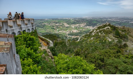 SINTRA, PORTUGAL - APRIL 5, 2018. Unidentified tourists at Palacio da Penas castle of mouros viewpoint in Sintra, Portugal.