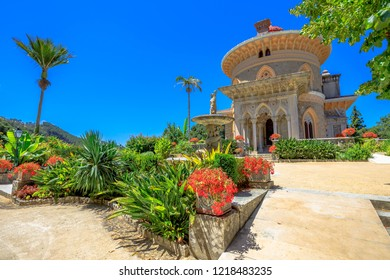 Sintra, Portugal - August 8, 2017: The arabesque Monserrate Palace or Palacio de Monserrate, the summer resort of Portuguese court. European travel. Sunny day in the blue sky.