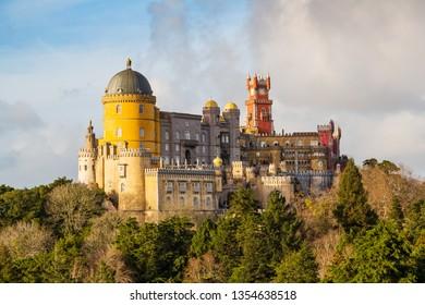 Sintra, Portugal - January 1 2013: Remote view of the national monument of Pena Palace (portug.: Palacio da Pena), a Romanticist castle in Sao Pedro de Penaferrim.
