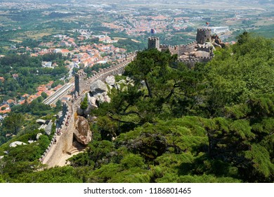 SINTRA, PORTUGAL - JULY 03, 2016:  The beautiful view from the Royal tower to the Moorish Castle on the top of the mountain over the Sintra town. Sintra. Portugal