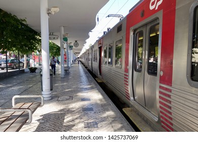 SINTRA, PORTUGAL - JULY 15, 2014: A Comboios de Portugal train pulls into the station in Sintra, Portugal on July 15, 2014. Sintra is a popular resort town near Lisbon.
